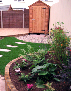 Raised Beds, Decking and lawn stepping stones